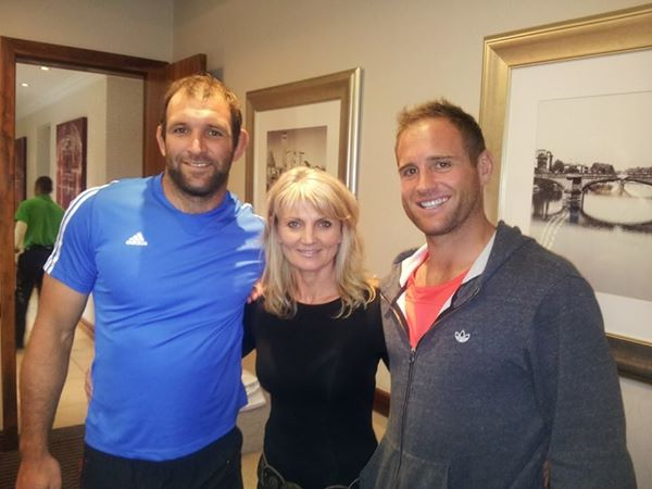 George Whitelock and Andy Ellis part of the 2014 Crusaders rugby squad seen here with co-owner of Infacet Jewellers, Brigitte Jenkinson