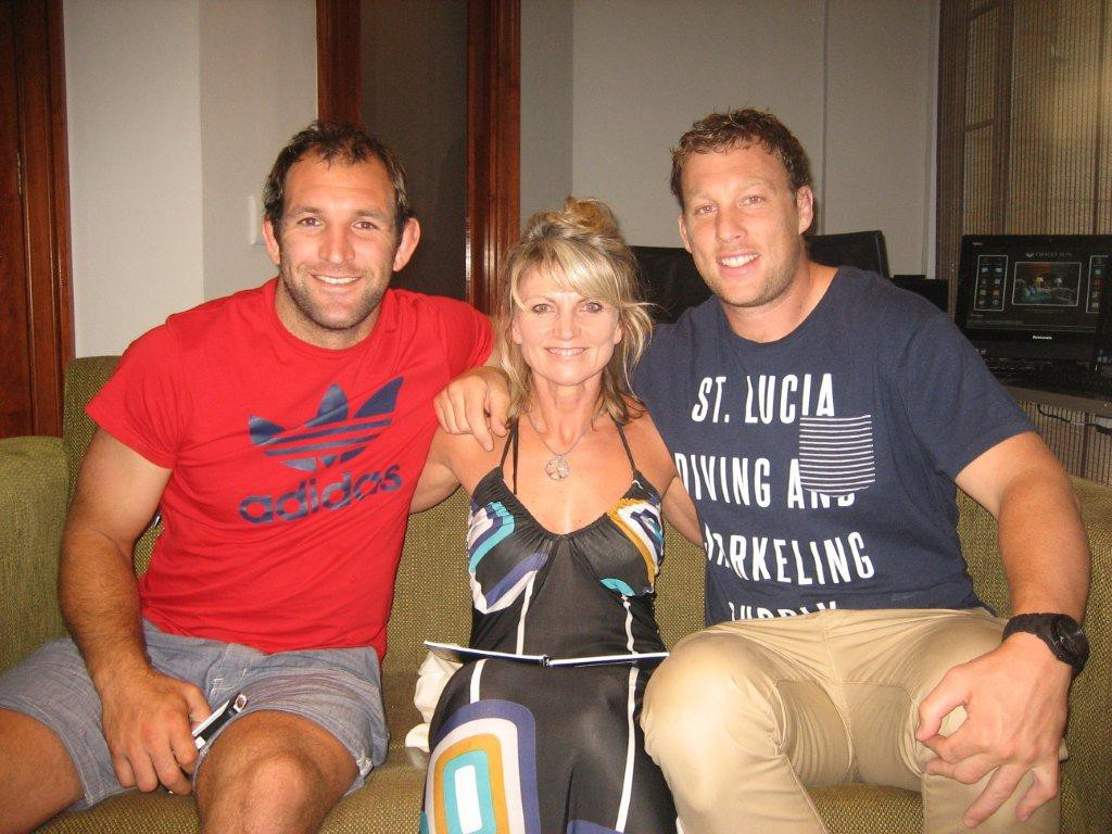 George WhiteLock and Wyatt Crockett part of the Crusaders 2013 rugby squad seen here with Brigitte Jenkinson